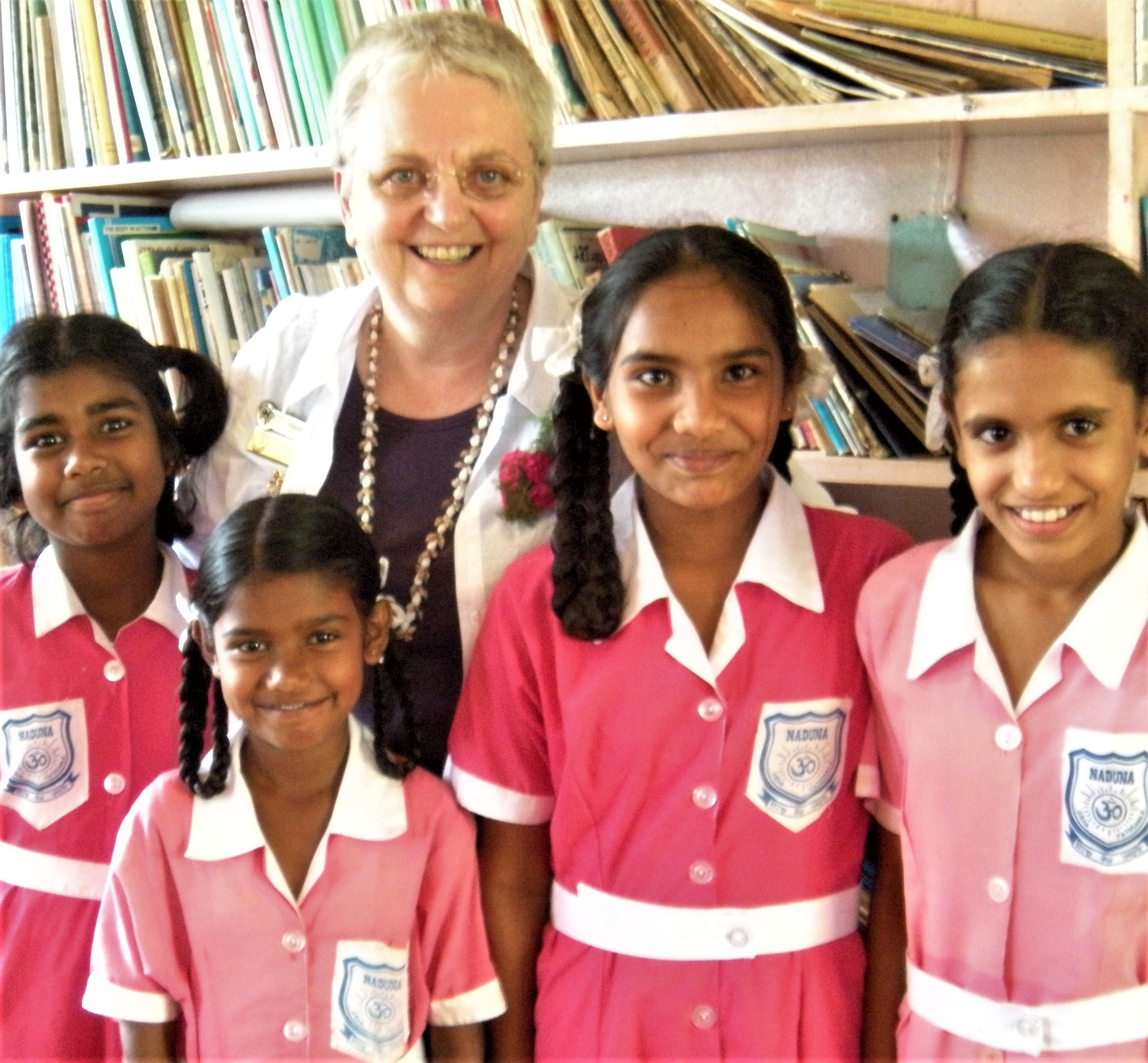 Yvonne Simpson with school girls Labasa